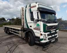 2004 Volvo FM9 6x2 26 Tons Flatbed, Rear Lift, Sleeper Cab, very clean truck of its year